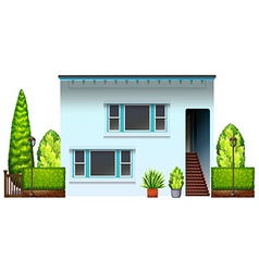 A big residential house with plants vector