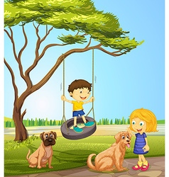 Boy and girl playing in the park vector image