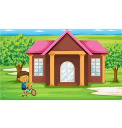 a boy infront of house vector image