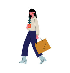 Young woman walking with shopping bag and house vector