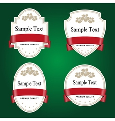 Set of white labels with red tape vector image