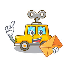 With envelope cartoon clockwork toy car in table vector