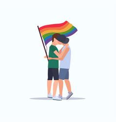 Couple gays holding lgbt rainbow flag love parade vector