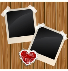 Blank photos on a wooden wall vector image