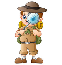 Boy explorer with magnifying glass vector