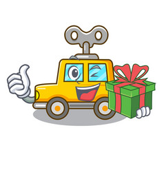 With gift cartoon clockwork toy car for gift vector