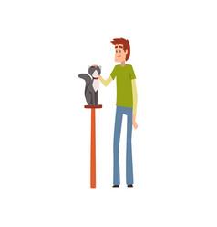 Young man presenting his purebred pet at cat vector
