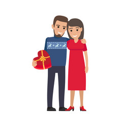 couple hugs and makes gift holiday vector image vector image