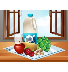 Milk and fresh vegetables on table vector