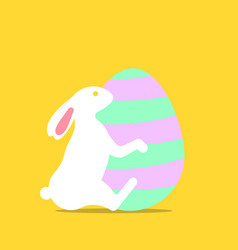 easter bunny hugging easter egg vector image