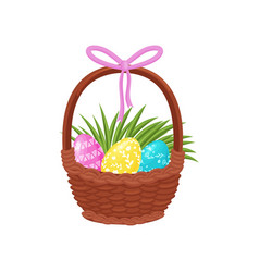 cute painted easter eggs and green grass in basket vector image