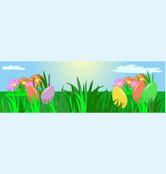 easter eggs on a spring meadow flowers and grass vector image