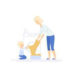 young woman doing laundry little son helping her vector image