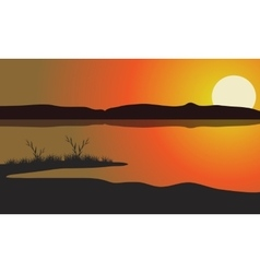 Lake at the sunset scenery vector