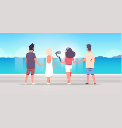 people group on beach using selfie stick taking vector image