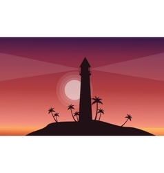 Silhouette of lighthouse on hill scenery vector