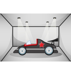A black luxury car inside a garage vector image