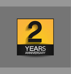 2 years anniversary in square yellow and black vector