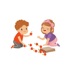 Cute boy and girl sitting on the floor and playing vector