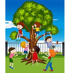Children climbing the tree in the park vector image