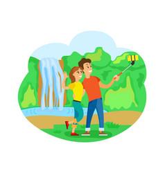 Travelers couple at waterfall taking selfie trip vector
