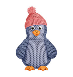 A funny knitted penguin toy in knitted winter cap vector