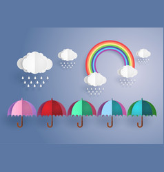 colorful umbrella in the rain with rainbow vector image
