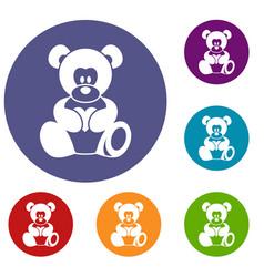 Teddy bear holding a heart icons set vector