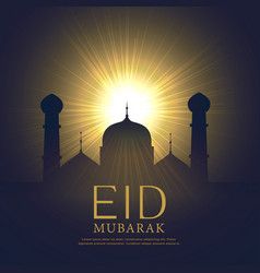 Mosque silhouette with glowing light eid mubarak vector