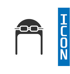 Grey aviator hat with goggles icon isolated on vector
