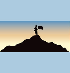man holding flag on top mountain vector image