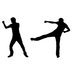 Silhouettes of fighting men vector