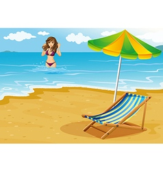 A beach with a lady in a purple bikini vector image vector image