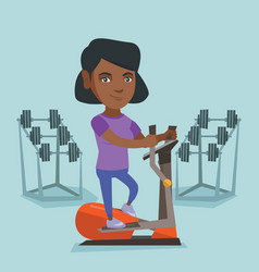 African woman exercising on elliptical trainer vector