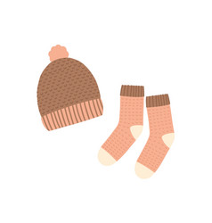 Knitted hat and socks flat vector
