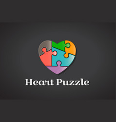 Puzzle love heart autism awareness logo design vector