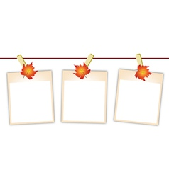 Blank Photos with Maple Leaves on Clothesline vector image vector image