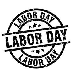 Labor day round grunge black stamp vector