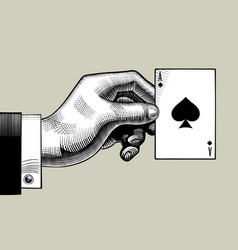 hand with the ace of spades playing card vintage vector image