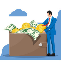 businessman putting big dollar coin in wallet vector image