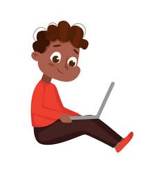 Cute little african american using laptop vector
