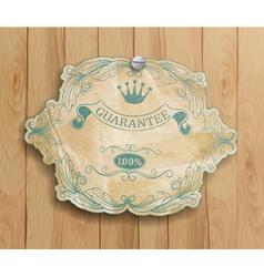 vintage label on the wooden background vector image
