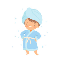 Little boy wearing bathrobe standing with towel on vector