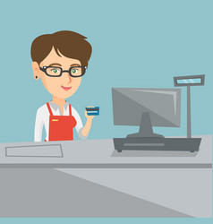 young caucasian cashier holding a credit card vector image