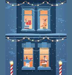 people in santa hats holding gifts mix race vector image