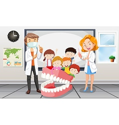 Dentists and children in classroom vector image