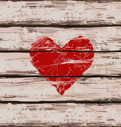 Heart symbol on wooden boards vector image vector image