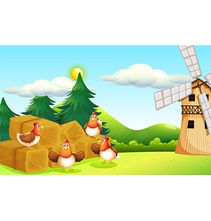 Four chickens at the hay with a windmill vector image vector image