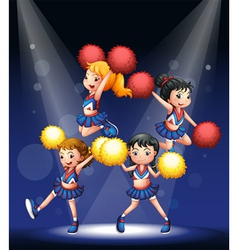 Cheerdancers performing at the stage vector image vector image