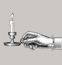 Womans hand holding a candlestick with burning vector